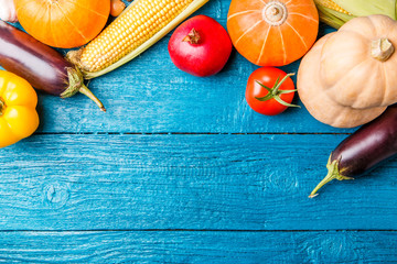 Photo of blue wooden table with autumn vegetable