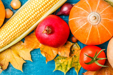 Photo on top of autumn leaves, pumpkin, , pomegranate, corn