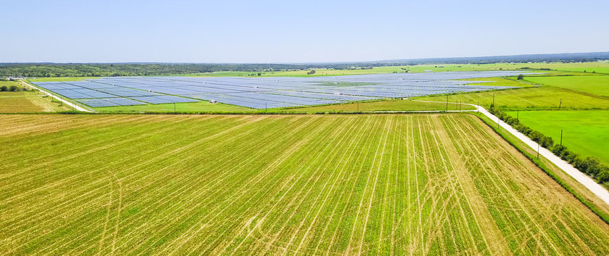 Panorama aerial view of solar farm near Austin, Texas, USA. Renewable energy background.