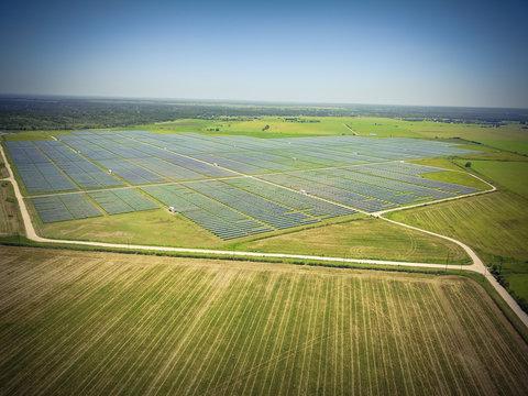 Aerial view of solar farm near Austin, Texas, USA. Renewable energy background. Vintage tone.