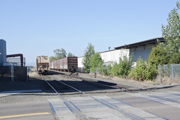 Train tracks through industrial area