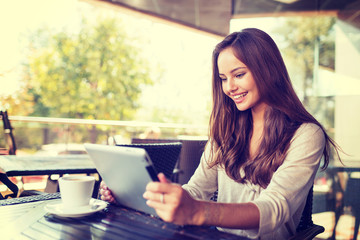 Young woman in cafe  using tablet