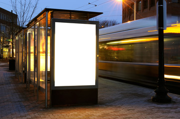 Blank billboard on bus stop at night Fotomurales
