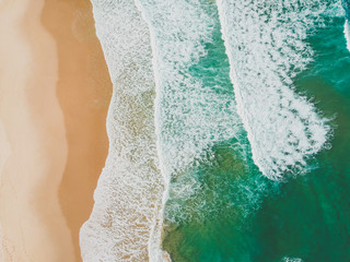 Aerial view of waves crashing on beach