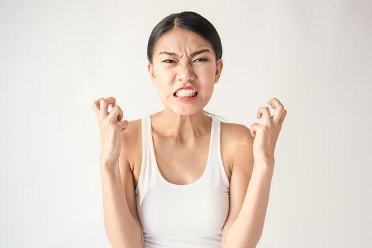 portrait of angry pensive mad crazy asian woman screaming out (expression, facial), beauty portrait of young asian woman madly panic isolated on white background.