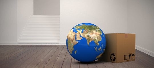 Composite image of 3d planet earth and cardboard box against
