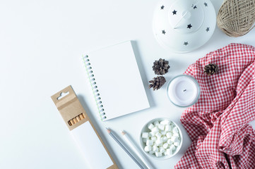 Notebook and Christmas decorations on white background