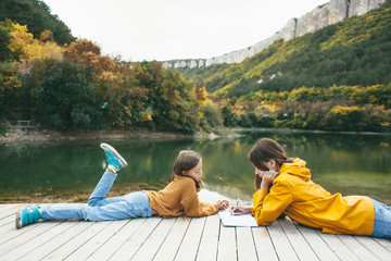 Children spending time by the lake