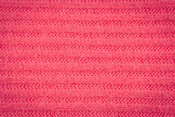 Knitted fabric - macro of a pink woolen texture