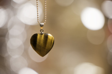 heart stone pendant necklace with glowing blurred background