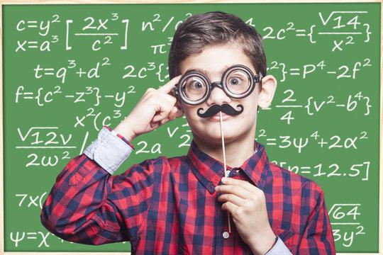 Funny math genius kid. Education concept