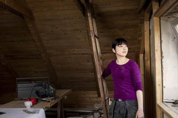 Woman during attic renovation