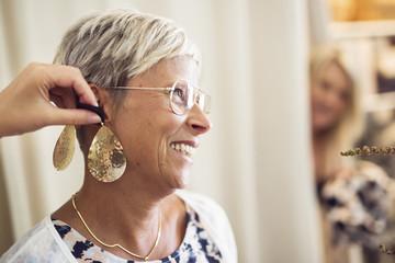 Woman trying earrings
