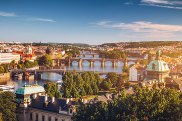 Spoed Fotobehang Praag Scenic spring sunset aerial view of the Old Town pier architecture and Charles Bridge over Vltava river in Prague, Czech Republic