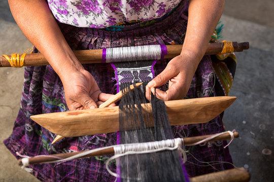 San Pedro la Laguna, Guatemala: hand of a Mayan woman making a traditional belt