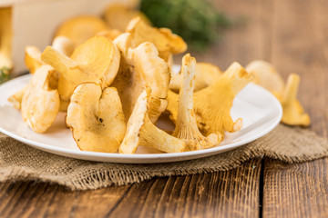 Portion of fresh harvested Chanterelles on wooden background