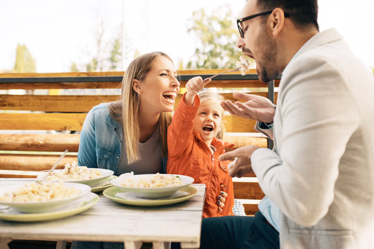 Family enjoying pasta