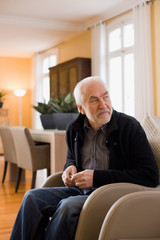 old man sitting in chair
