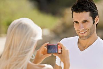 A latin male having his photo taken