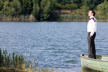 businessman in standing in rowboat