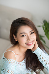Young asian woman relaxing at her home.