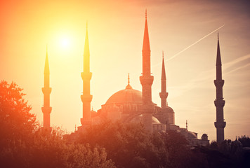 silhouette mosque on sunset time,silhouette with sunlight effect on sunset time and colorful sky background