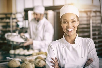 Happy female baker smiling at camera
