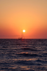 Seascape scenic sunset with a boat.