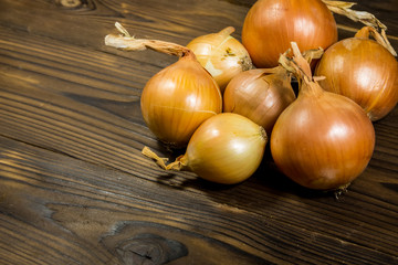Raw onion on wooden table