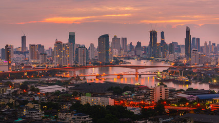 Bangkok's morning atmosphere amidst the tall buildings in the city.