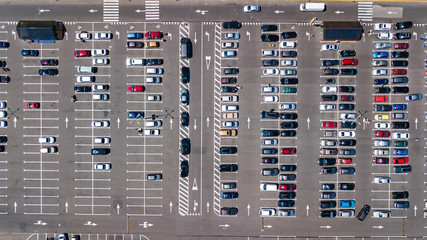 Aerial top view of parking lot with many cars from above, transportation and urban concept