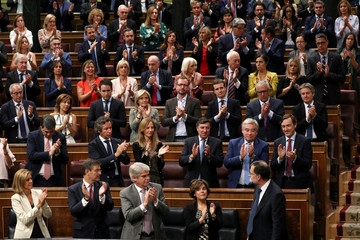 Spain's Prime Minister Mariano Rajoy receives applause from members of his People's Party (PP) after his speech to Parliament in Madrid