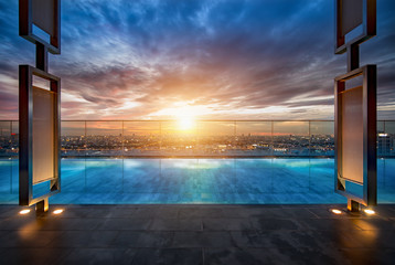 Sky swimming pool with the sofa on the rooftop in the city at Bangkok, Thailand.