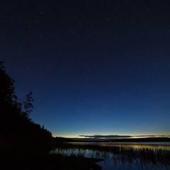 The stars in the night sky over the river.
