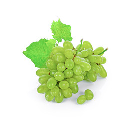 Green grape with leaves isolated on white.