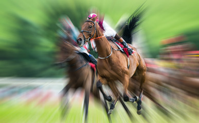 Motion blur effect on galloping racehorse and jockey