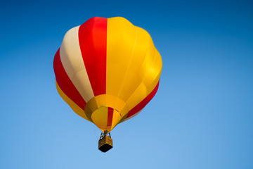 Fotobehang Luchtsport Colorful of Hot air balloon with fire and blue sky background