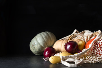 Autumn meal. Ripe pumpkins. Holiday Hallow. Dark background.