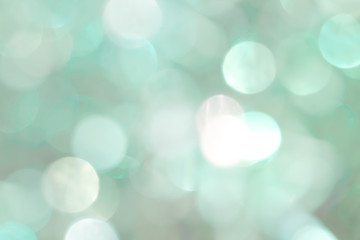 Shiny green New Year background for holiday card. Balls of different colors and sizes.