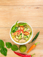 Chicken and spicy chili with green curry in coconut milk