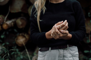 Blond woman holds hands