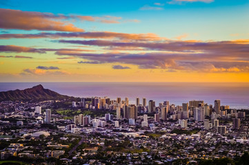 Aerial Purple and Gold Sunset Above Honolulu Skyline in Hawaii