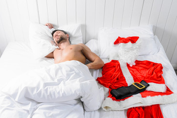 Santa Claus in hotel room without costume getting ready for Christmas or New Year