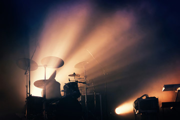 Drums on the stage, illuminated.