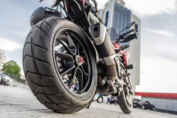 Rear wheel of Red motorcycle in the city street