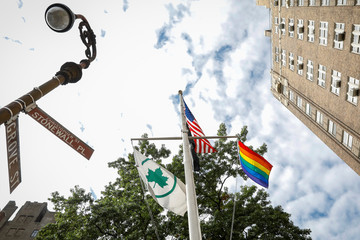 The Rainbow Flag, a symbol of LGBTQ freedom, flies over the Stonewall National Monument following a dedication ceremony in New York City