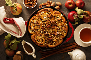 Cinnamon rolls with apples, caramel and pecan