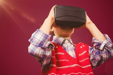Composite image of children using an oculus