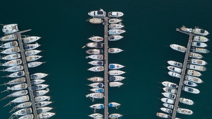 Fototapeta Aerial view of boats and yachts docked in marina
