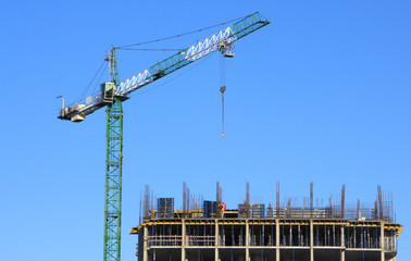 Residential buildings construction site with three working tower cranes background